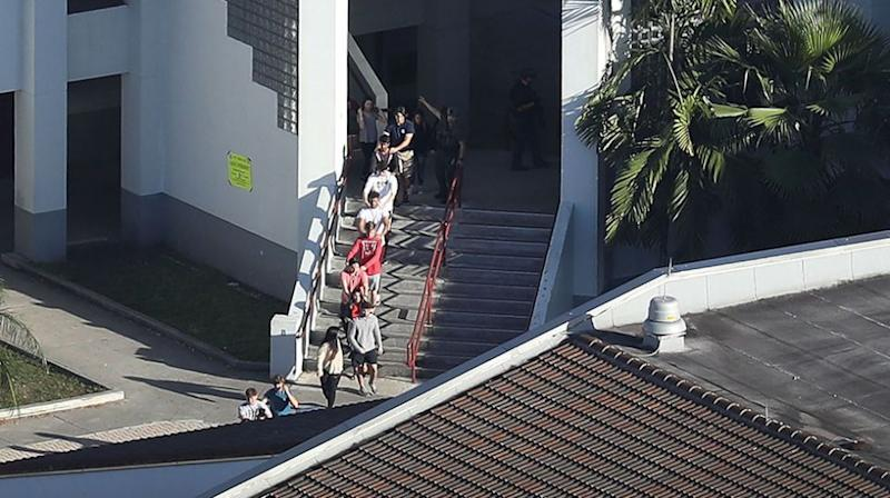 Students are escorted from the building. Source: Getty