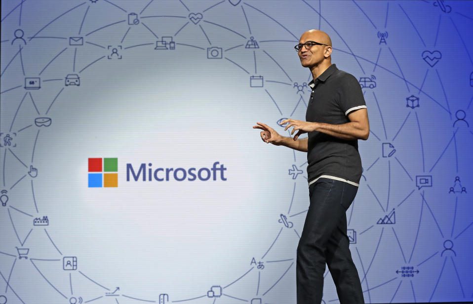 FILE- In this May 7, 2018, file photo Microsoft CEO Satya Nadella delivers the keynote address at Build, the company's annual conference for software developers in Seattle. Microsoft Corp. reports earnings Wednesday, Oct. 24. (AP Photo/Elaine Thompson, File)