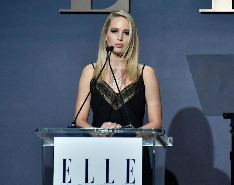 """Jennifer Lawrence says a producer took nude photos of her to """"inspire"""" her to lose weight"""