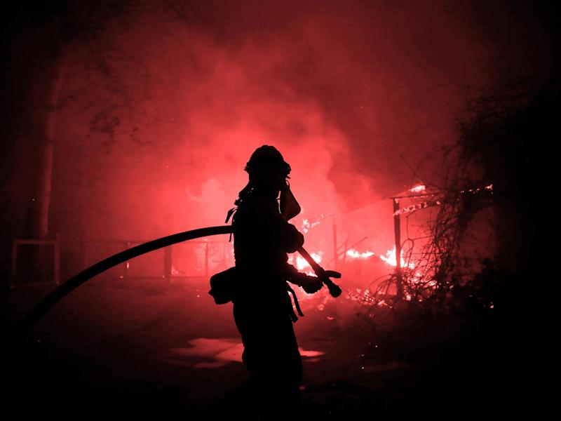 A firefighter battles the Woolsey Fire in Malibu, California: Eric Thayer/Reuters