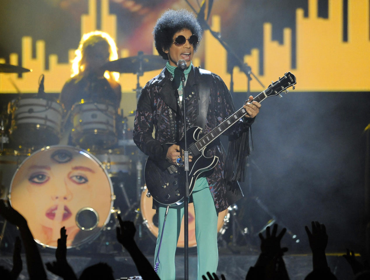 <p> FILE - In this May 19, 2013, file photo, Prince performs at the Billboard Music Awards at the MGM Grand Garden Arena in Las Vegas. In a newspaper report published Wednesday, May 4, 2016, Prince had arranged to meet a California doctor to try to kick an addiction to painkillers shortly before his death. (Photo by Chris Pizzello/Invision/AP, File) </p>