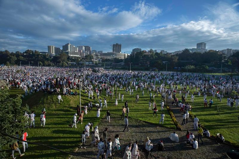 Ethiopians participate in the annual Irrecha thanksgiving festival in the capital Addis Ababa, Ethiopia Saturday, Oct. 5, 2019. The annual Irrecha festival of Ethiopia's largest ethnic group, the Oromo, attracted millions from across Ethiopia and was held in the capital for the first time after 150 years on Saturday.