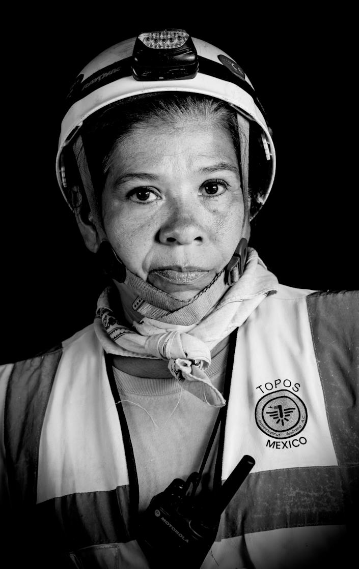 """<p>Pola Diaz, a 53-year-old social worker and rescuer who volunteered as a """"topo"""" (mole) — as the diggers who burrow their way into collapsed buildings are known — after the 7.1 earthquake that hit Mexico. (Photo: Omar Torres/AFP/Getty Images) </p>"""