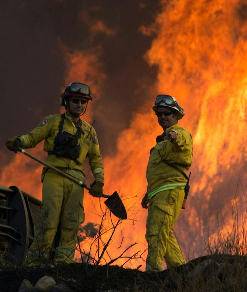 California is in its fifth year of a record drought, with a heat wave and strong seasonal gusts known as the Santa Ana winds, a recipe for perfect wildfire conditions (AFP Photo/Robyn Beck)