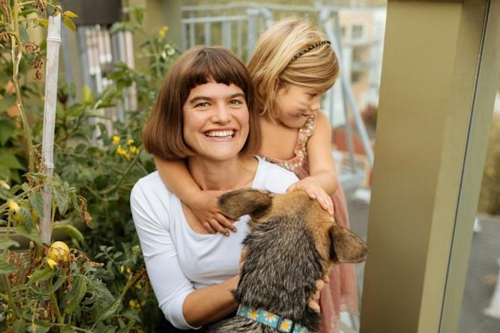 Author Michaeleen Doucleff with her daughter Rosy and their shepherd, Mango, at home in San Francisco.