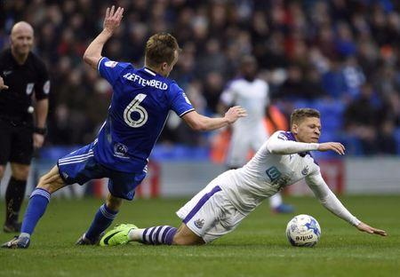Newcastle United's Dwight Gayle is fouled by Birmingham City's Maikel Kieftenbeld