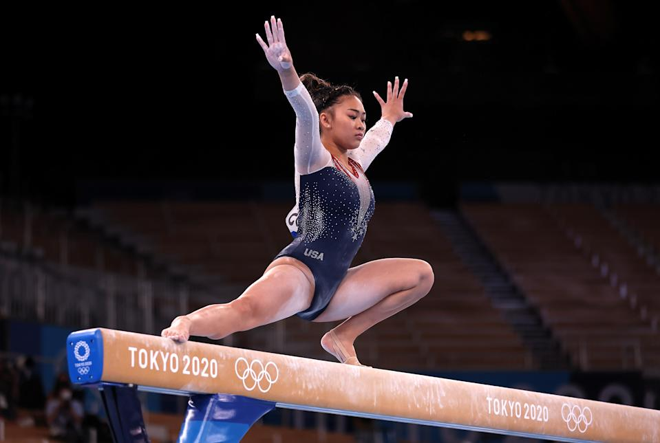 <p>TOKYO, JAPAN - JULY 29: Sunisa Lee of Team United States competes on balance beam during the Women's All-Around Final on day six of the Tokyo 2020 Olympic Games at Ariake Gymnastics Centre on July 29, 2021 in Tokyo, Japan. (Photo by Jamie Squire/Getty Images)</p>