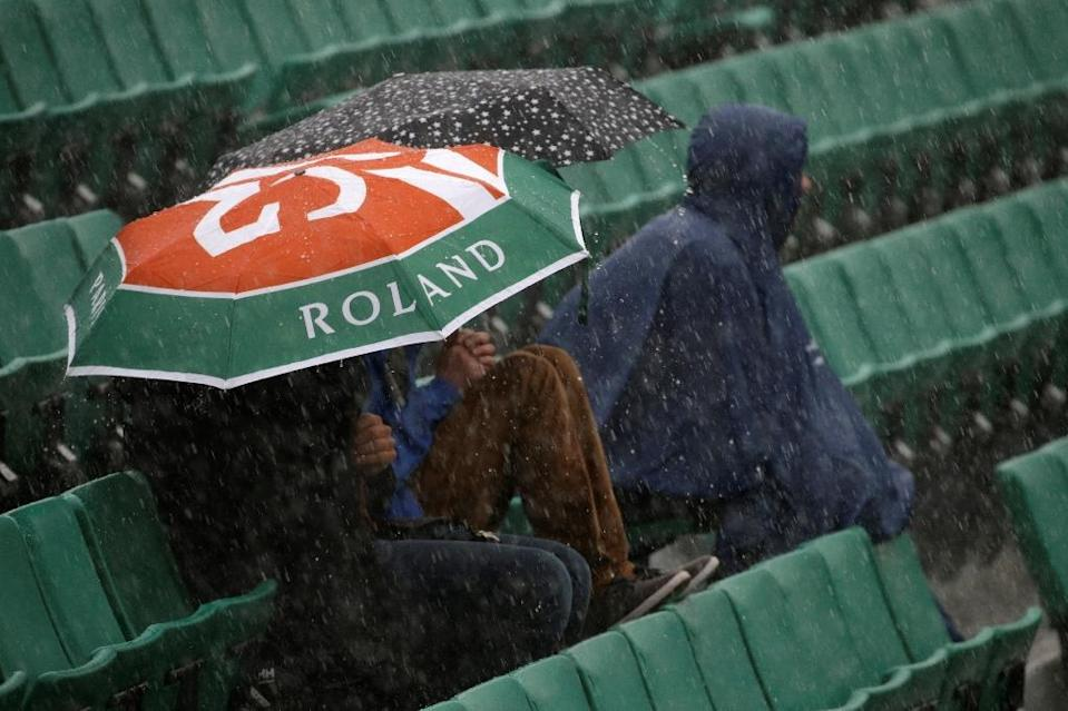 Further rain in Paris has been forecast throughout Tuesday before conditions are due to brighten on Wednesday, but the wash-out is creating a severe backlog of matches at the French Open (AFP Photo/Thomas Samson)
