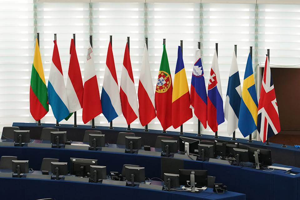 STRASBOURG, FRANCE - JANUARY 27: The British Union Jack flag (R) is displayed amongst European Union member countries' national flags inside of the European Parliament on January 27, 2020 in Strasbourg, France. The United Kingdom is set to depart the European Union on January 31, entering a transition period in which it will negotiate a new trade agreement with the bloc. (Photo by Thomas Niedermueller/Getty Images)