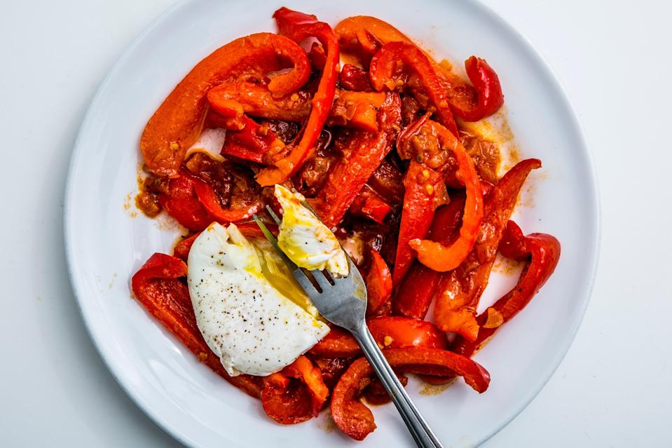 """Breakfast, lunch, or dinner: this vegetable-forward, protein-packed meal doesn't need meat. <a href=""""https://www.bonappetit.com/recipe/tunisian-style-poached-eggs-in-red-pepper-sauce?mbid=synd_yahoo_rss"""" rel=""""nofollow noopener"""" target=""""_blank"""" data-ylk=""""slk:See recipe."""" class=""""link rapid-noclick-resp"""">See recipe.</a>"""