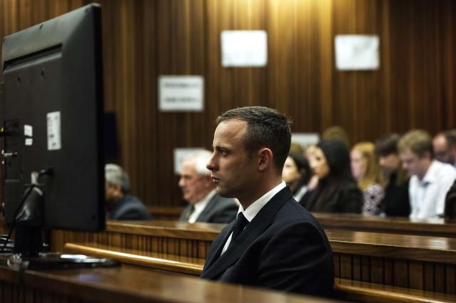 South African Olympic and Paralympic athlete Oscar Pistorius looks on during his murder trial in the North Gauteng High Court in Pretoria, April 16, 2014. Pistorius is on trial for murdering his girlfriend Reeva Steenkamp at his suburban Pretoria home on Valentine's Day last year. REUTERS/Gianluigi Guercia/Pool (SOUTH AFRICA - Tags: SPORT CRIME LAW)