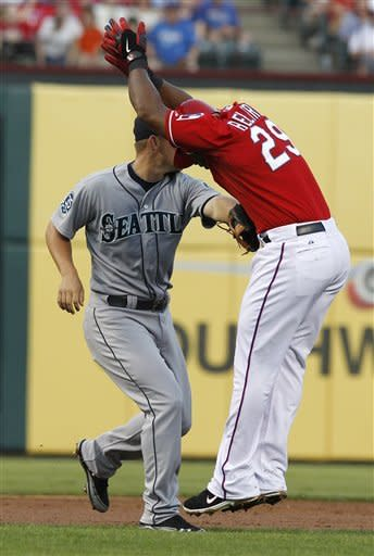 Texas Rangers' Adrian Beltre (29) is tagged out in a rundown between second and third by Seattle Mariners third baseman Kyle Seager during the second inning of a baseball game Tuesday, April 10, 2012, in Arlington, Texas. (AP Photo/LM Otero)