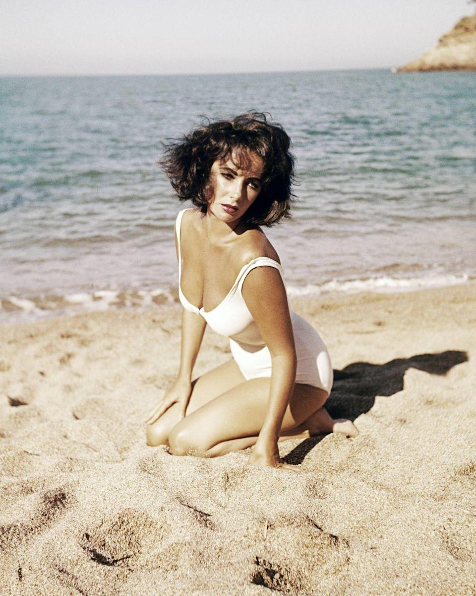 <p>The actress poses on a beach for her newest film, <em>Suddenly, Last Summer,</em> which she costarred in with Montgomery Clift and Katharine Hepburn.  </p>