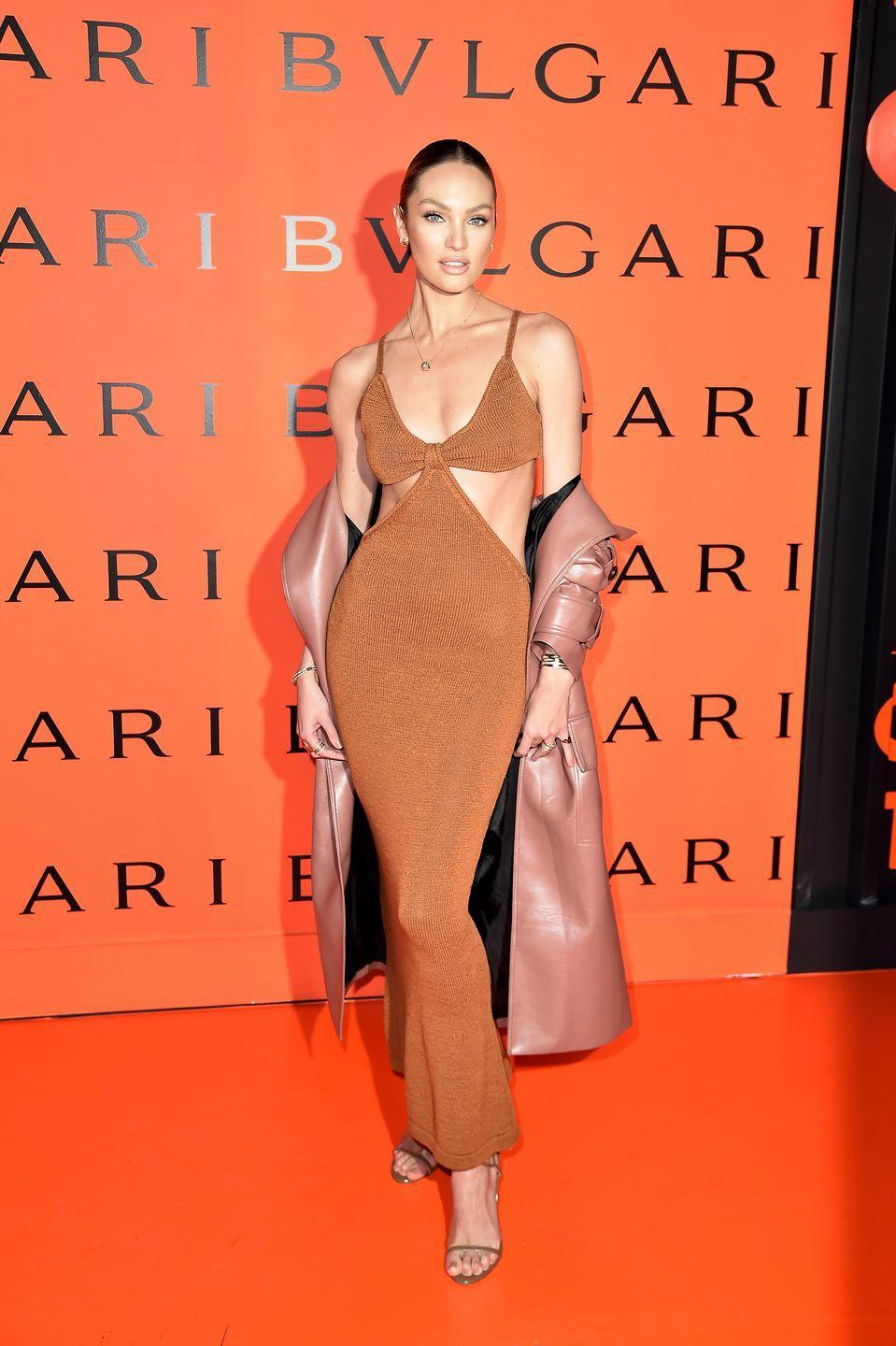 """<p>What a difference a year makes. From haute couture elements infiltrating our day-to-day garbs in 2019 to leisurewear becoming de rigueur in 2020, fashion experienced a drastic shift. Still, there was one item that stood out from the sea of sweats, and that was <a href=""""https://www.harpersbazaar.com/fashion/trends/a32702906/dress-of-summer-2020/"""" rel=""""nofollow noopener"""" target=""""_blank"""" data-ylk=""""slk:Cult Gaia's Serita dress"""" class=""""link rapid-noclick-resp"""">Cult Gaia's Serita dress</a>. Made of stretch knit and featuring sleek cutouts, the frock was a favorite of the stylish set, including Candice Swanepoel, who wore it on the red carpet, and Hailey Bieber, who donned the dress on an island vacation. </p>"""