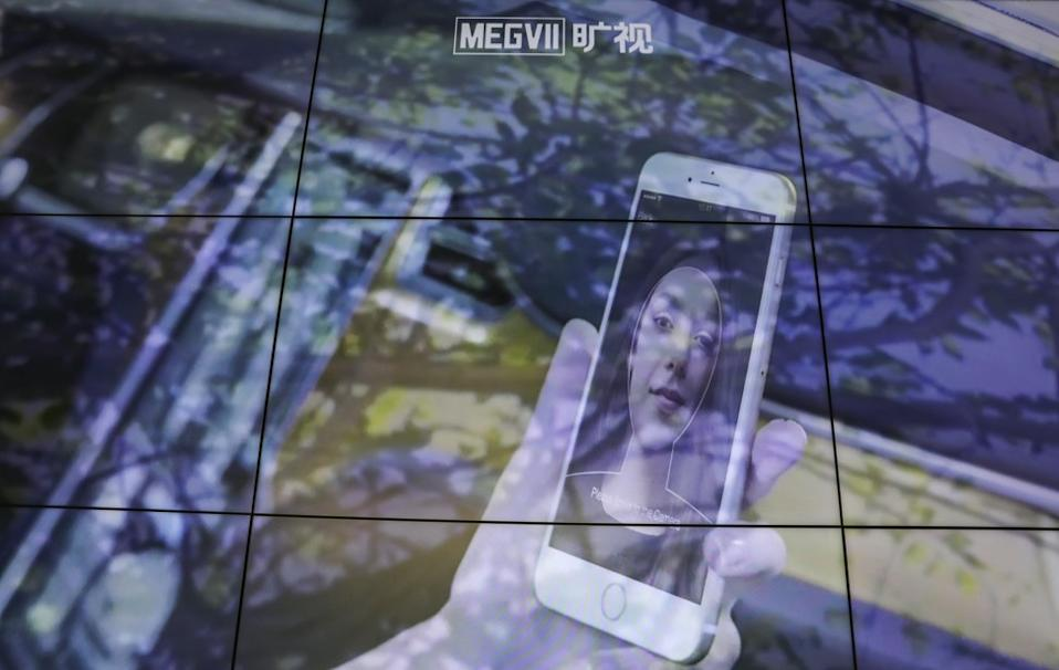 A big screen shows facial recognition technology at the headquarters of Megvii (or Face++) in Beijing in May. Photo: Simon Song