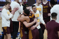 Loyola Chicago center Cameron Krutwig (25) and Loyola Chicago guard Lucas Williamson (1) celebrate after beating Illinois 71-58 after a men's college basketball game in the second round of the NCAA tournament at Bankers Life Fieldhouse in Indianapolis, Sunday, March 21, 2021. (AP Photo/Paul Sancya)