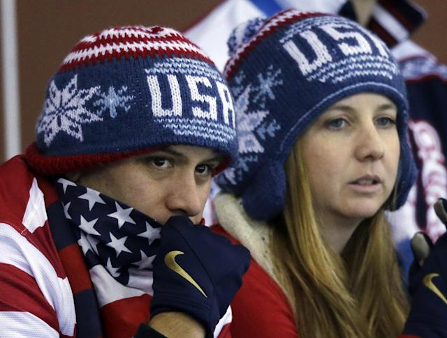 Some USA fans watch the round robin women's curling match between the United States and Denmark at the 2014 Winter Olympics, Friday, Feb. 14, 2014, in Sochi, Russia. (AP Photo/Morry Gash)
