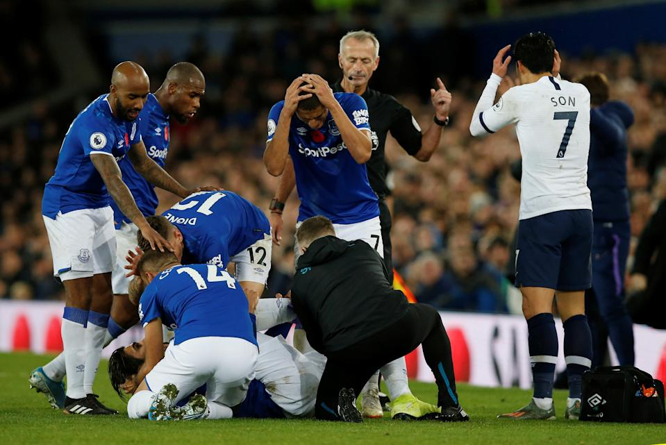 Everton and Tottenham players reacted with horror after Everton's André Gomes suffered a gruesome injury in Sunday's Premier League match. (Reuters/Andrew Yates)