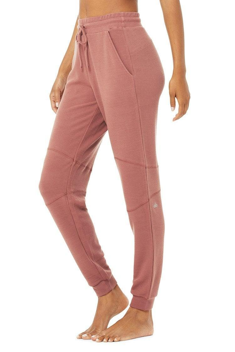 """<h2>Alo Yoga Micro Waffle Fireside Sweatpant</h2><br><strong>Available Sizes: XXS-L</strong><br>Pair these tailored micro-waffle-knit sweats with <a href=""""https://www.aloyoga.com/products/w3579r-micro-waffle-relaxation-pullover-bone"""" rel=""""nofollow noopener"""" target=""""_blank"""" data-ylk=""""slk:Alo's Relaxation Pullover"""" class=""""link rapid-noclick-resp"""">Alo's Relaxation Pullover</a> cut from the same comfy AF cloth. It's a recipe for snuggle central.<br><br><em>Shop <strong><a href=""""https://www.aloyoga.com/products/w5943r-micro-waffle-fireside-sweatpant-chestnut"""" rel=""""nofollow noopener"""" target=""""_blank"""" data-ylk=""""slk:Alo Yoga"""" class=""""link rapid-noclick-resp"""">Alo Yoga</a></strong></em><br><br><strong>Alo Yoga</strong> Micro Waffle Fireside Sweatpant, $, available at <a href=""""https://go.skimresources.com/?id=30283X879131&url=https%3A%2F%2Fwww.aloyoga.com%2Fproducts%2Fw5943r-micro-waffle-fireside-sweatpant-chestnut"""" rel=""""nofollow noopener"""" target=""""_blank"""" data-ylk=""""slk:Alo Yoga"""" class=""""link rapid-noclick-resp"""">Alo Yoga</a>"""