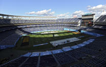 FILE - In this Dec. 27, 2019, file photo, a detailed view SDCCU stadium before the Holiday Bowl NCAA college football game in San Diego. The school has also begun looking at how it could safely host fans within social distancing guidelines, if fans will be allowed to attend games at 70,000-seat SDCCU Stadium. This season, 39 major college football schools have scheduled 49 so-called buy games worth an estimated $65 million. If coronavirus disruptions cause Power Five teams to play more or only conference games, stretched athletic budgets could face huge holes. (AP Photo/Orlando Ramirez, File)