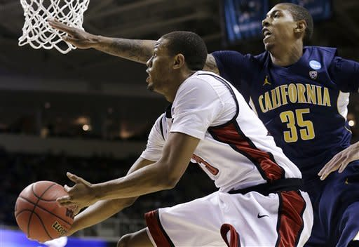 UNLV guard Bryce Dejean-Jones (13) shoots against California forward Richard Solomon (35) during the first half of a second-round game in the NCAA college basketball tournament in San Jose, Calif., Thursday, March 21, 2013. (AP Photo/Jeff Chiu)