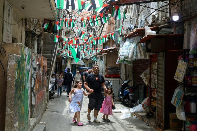 Palestinian flags line an alley in the Palestinian refugee camp of Shatila in Lebanon's capital Beirut on May 21