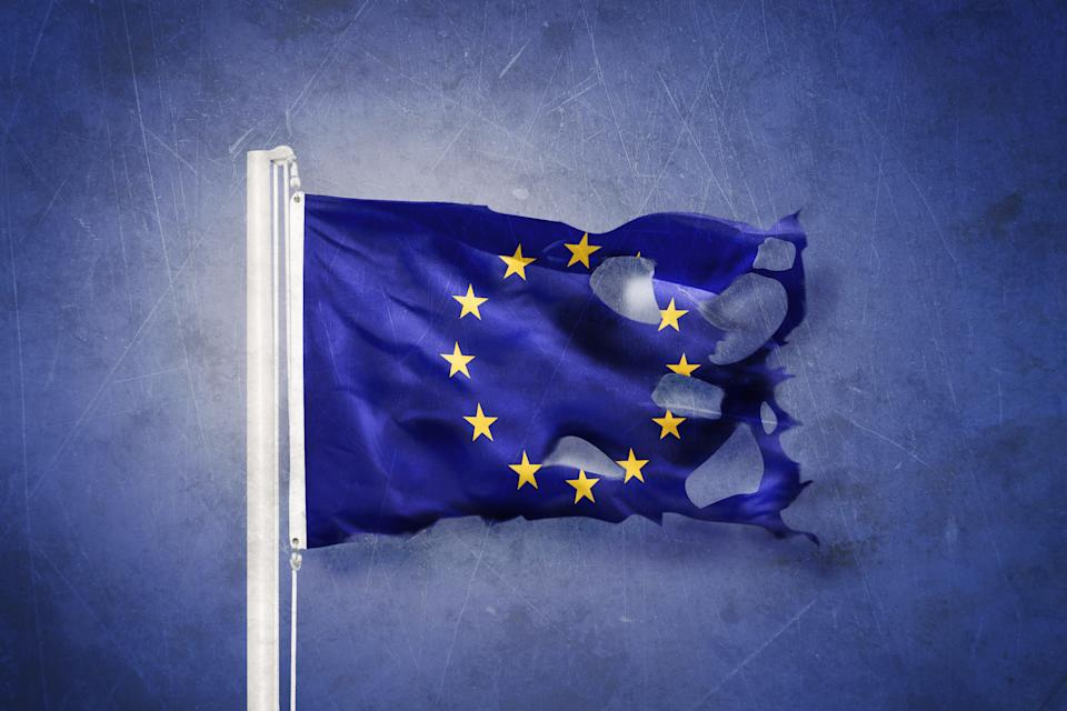 Torn European Union flag against grunge background. Photo: Getty