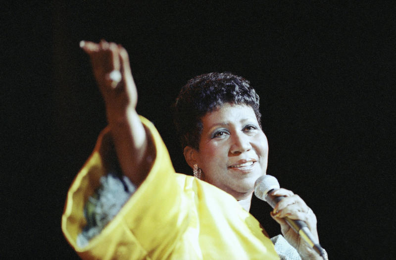 "Among Aretha Franklin's most famous hits was her signature song, ""Respect,"" which became a rallying cry for women as well as for black empowerment. She's seen here performing at New York's Radio City Music Hall in 1989. (Mario Suriani/AP)"
