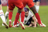 United States' Megan Rapinoe falls to the ground during a women's semifinal soccer match against Canada at the 2020 Summer Olympics, Monday, Aug. 2, 2021, in Kashima, Japan. (AP Photo/Fernando Vergara)