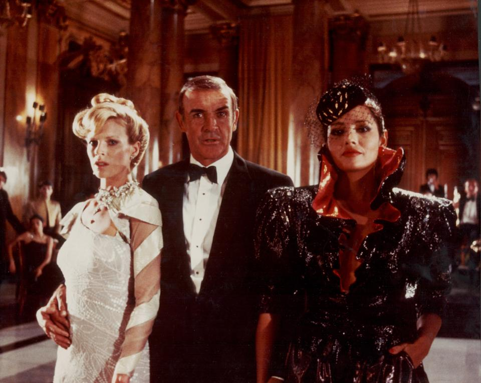 Actor Sean Connery as James Bond, with 'Bond girls' Kim Basinger and Barbara Carrera, in a scene from the film 'Never Say Never Again', 1983. (Photo by Stanley Bielecki Movie Collection/Getty Images)