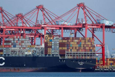 A container ship is shown at port in Long Beach, California