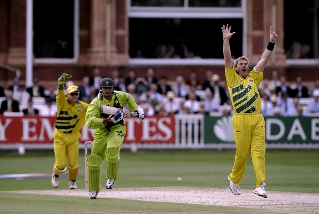 20 Jun 1999:  Shane Warne of Australia takes the wicket of Shahid Afridi of Pakistan during the Cricket World Cup Final at Lord's in London. Australia won by 8 wickets. \ Mandatory Credit: Laurence Griffiths /Allsport
