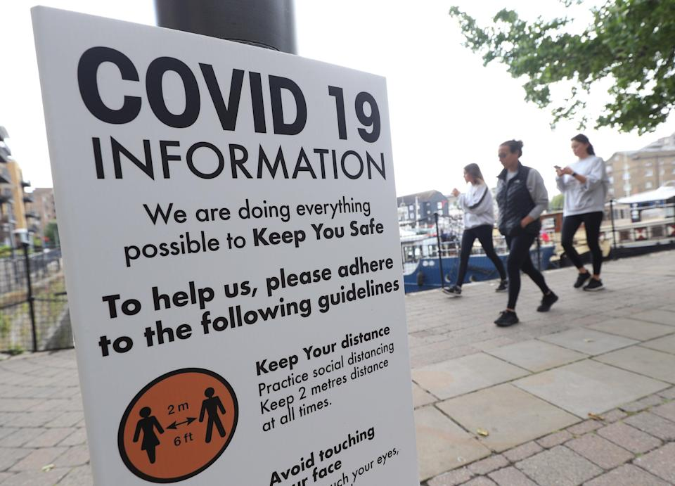 Signage related to social distancing and Covid-19 on display in London (Yui Mok/PA) (PA Wire)