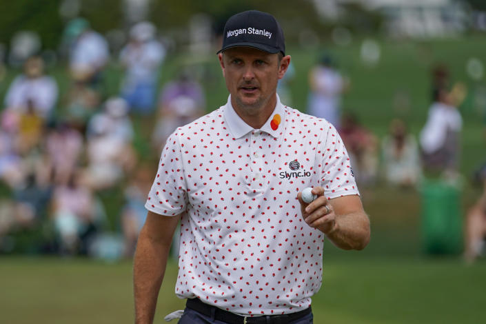 Justin Rose, of England, holds up his ball after a birdie on the second hole during the final round of the Masters golf tournament on Sunday, April 11, 2021, in Augusta, Ga. (AP Photo/Matt Slocum)