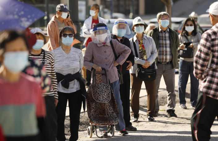 People with appointments line up at a vaccination clinic in Chinatown for senior citizens on Feb. 24, 2021 in Los Angeles, CA. (Al Seib/Los Angeles Times via Getty Images).