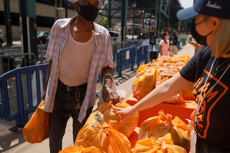 Local residents receive food items as Food Bank For New York City teams up with the New York Yankees to kick-off monthly food distribution for New Yorkers in need at Yankee Stadium on May 20, 2021 in New York City.  (Getty Images for Food Bank For N)