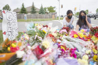 <p>Mourners place flowers at the scene of a hate-motivated vehicle attack in London, Ontario on Tuesday, June 8, 2021, which left four members of a family dead and sent one to hospital. Police have charged a London man with four counts of murder and one count of attempted murder. THE CANADIAN PRESS/ Geoff Robins</p>