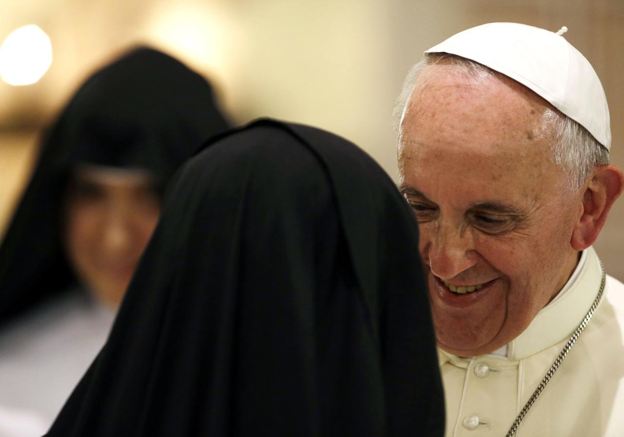 Pope Francis smiles during a meeting with cloistered nuns at the St. Chiara Basilica in Assisi October 4, 2013. Pope Francis visits Assisi, the Italian town that was home to his namesake St. Francis of Assisi. Pope Francis took his name from the saint who is revered around the world as a symbol of austerity, simplicity, concern for the poor and a love of the environment. REUTERS/Gregorio Borgia/Pool (ITALY - Tags: RELIGION)