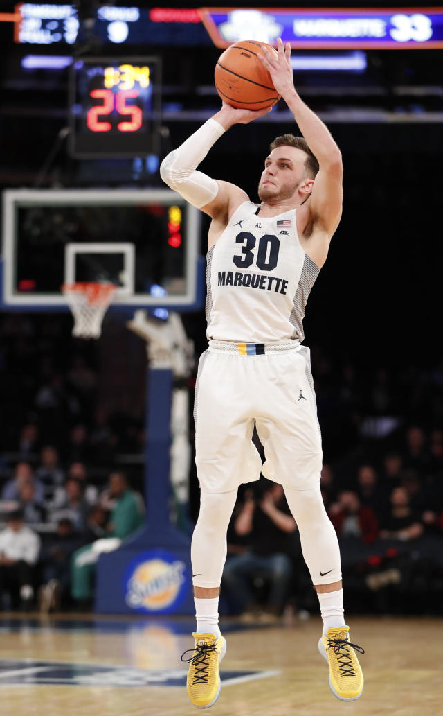 Marquette guard Andrew Rowsey (30) shoots a three-point shot during the first half of an NCAA college basketball game in the first round of the Big East conference tournament, in New York, Wednesday, March, 7, 2018. (AP Photo/Kathy Willens)