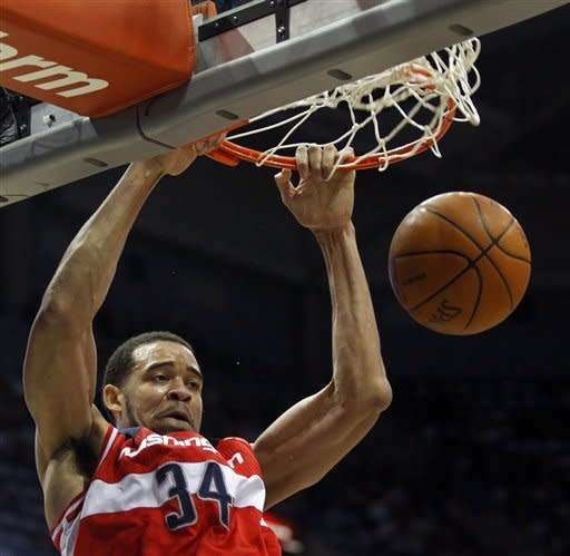 Washington Wizards' JaVale McGee(34) dunks the ball against the Milwaukee Bucks during the first half of an NBA basketball game, Tuesday, Feb. 28, 2012, in Milwaukee. (AP Photo/Jeffrey Phelps)