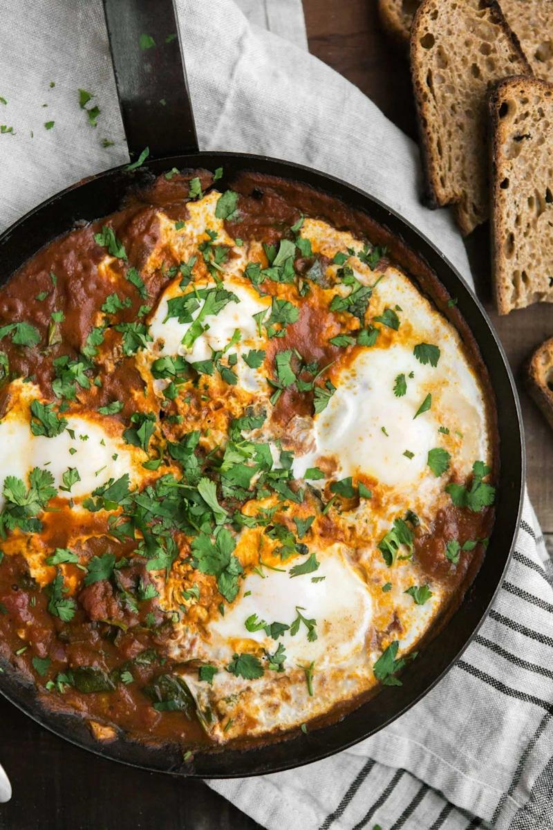 "<strong>Get the <a href=""https://naturallyella.com/curried-eggs-spinach/"" target=""_blank"">Curried Eggs with Spinach recipe</a>&nbsp;from Naturally Ella</strong>"