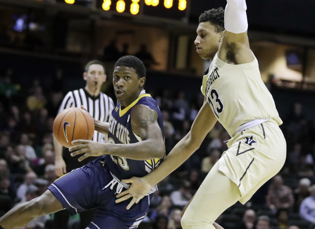 Kent State guard Jaylin Walker (23) drives against Vanderbilt forward Matthew Moyer (13) in the first half of an NCAA college basketball game Friday, Nov. 23, 2018, in Nashville, Tenn. (AP Photo/Mark Humphrey)