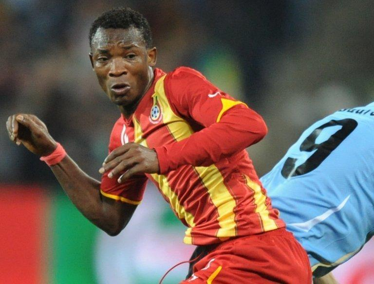 Ghana defender John Paintsil (L) pictured during the 2010 World Cup quarter-final against Uruguay on July 2, 2010
