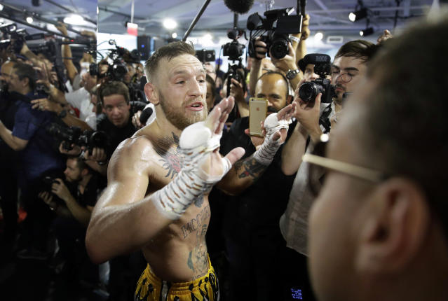 Conor McGregor reacts during a media workout in advance of his fight against Floyd Mayweather Jr. (AP)