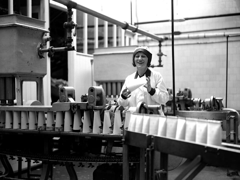 A woman at a milk bottling plant in the 1920s.