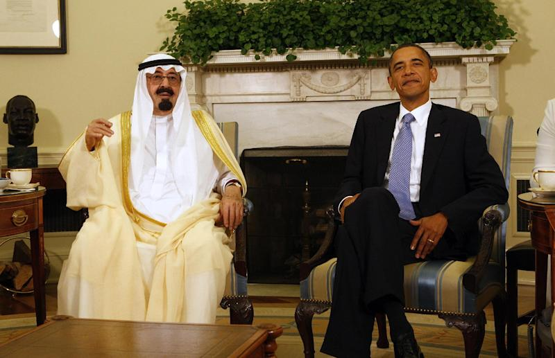 FILE - In this June 29, 2010 file photo, President Barack Obama meets with Saudi Arabia's King Abdullah in the Oval Office of the White House in Washington. President Barack Obama plans a trip to Middle East ally Saudi Arabia next month amid tension in the region. The White House announced Monday that Obama would meet with King Abdullah and discuss security in the region. U.S. policy toward Iran and Syria are certain to be on the list. The stop is being added on to a previously announced trip to Europe at the end of March. It will be Obama's first visit to Saudi Arabia since 2009. (AP Photo/Ron Edmonds, File)