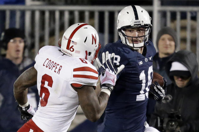 Penn State tight end Jesse James (18) gets past Nebraska safety Corey Cooper (6) for a touchdown after catching a pass from Penn State quarterback Christian Hackenberg (14) during fourth quarter of an NCAA college football game in State College, Pa., Saturday, Nov. 23, 2013. (AP Photo/Gene J. Puskar)
