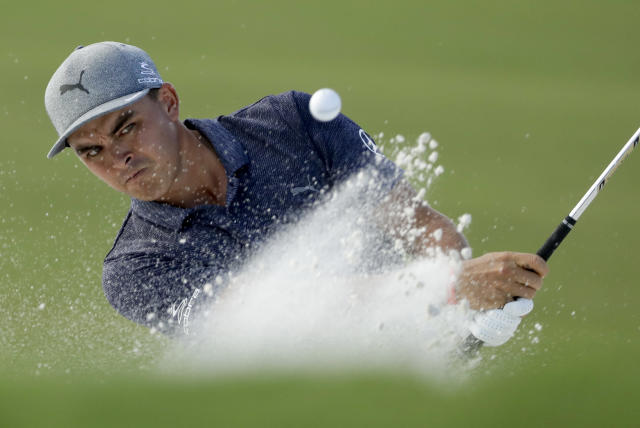 Rickie Fowler hits from the bunker on the 16th hole during the first round of the PGA Championship golf tournament at the Quail Hollow Club Thursday, Aug. 10, 2017, in Charlotte, N.C. (AP Photo/Chris O'Meara)