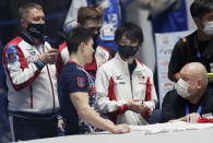 Kohei Uchimura of Japan, center right, chats with Russian team members after he wrote an autograph on a T-shirt at the end of an international gymnastics meet in Tokyo on Sunday, Nov. 8, 2020. Three-time Olympic gold-medal gymnast Uchimura wants the postponed Tokyo Olympics to happen in just under nine months. But he's also talked openly about the skepticism in Japan where enthusiasm is muted by health risks, billions of dollars in taxpayer bills, and questions why the Games are a priority amid a pandemic. (AP Photo/Hiro Komae)