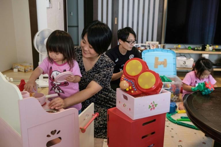 Manami Ito is raising her two daughters to understand and appreciate diversity (AFP/Yuki IWAMURA)